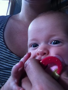 Nom nom nom!  And yes, that's her hand, my fingers AND the nuk in her mouth!