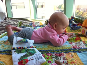 I placed her quilt right by the floor to ceiling window- she watched trucks and people all day!
