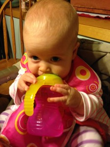 Ella loves her sippy cup!  We're not sure if she drinks the water or just lets it pool in her mouth, but it's cute!